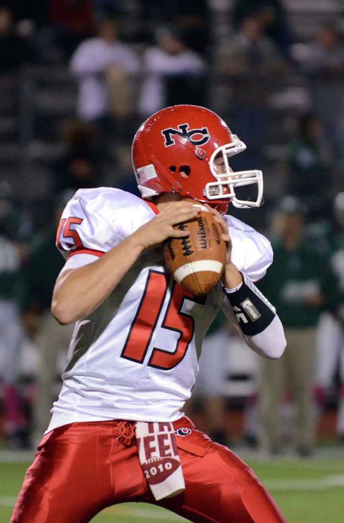 New Canaan's quarterback Matt Milano (15) prepares to throw a pass during the football game against Norwalk at Norwalk High School on Friday, Oct. 14, 2011.
