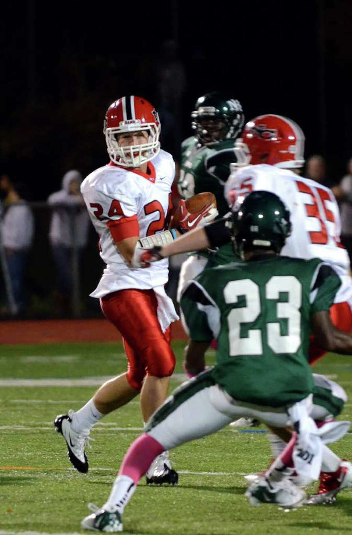 New Canaan's Patrick Newton (24) carries the ball during the football game against Norwalk at Norwalk High School on Friday, Oct. 14, 2011.