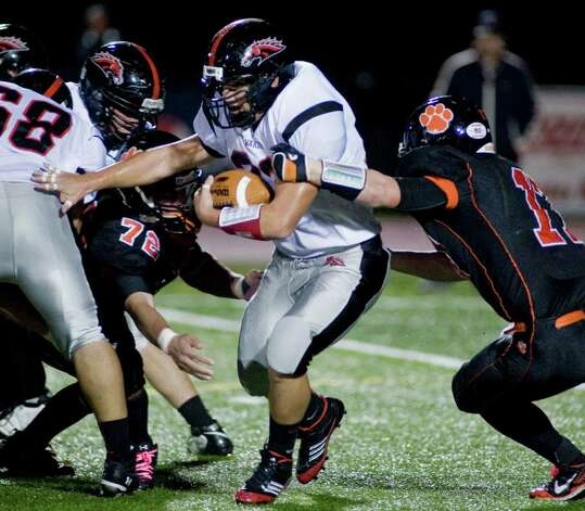Fairfield Warde's David Wolff carries the football during a game against Ridgefield High School, at Ridgefield. Friday, oct. 14, 2011 Photo: Scott Mullin / The News-Times Freelance