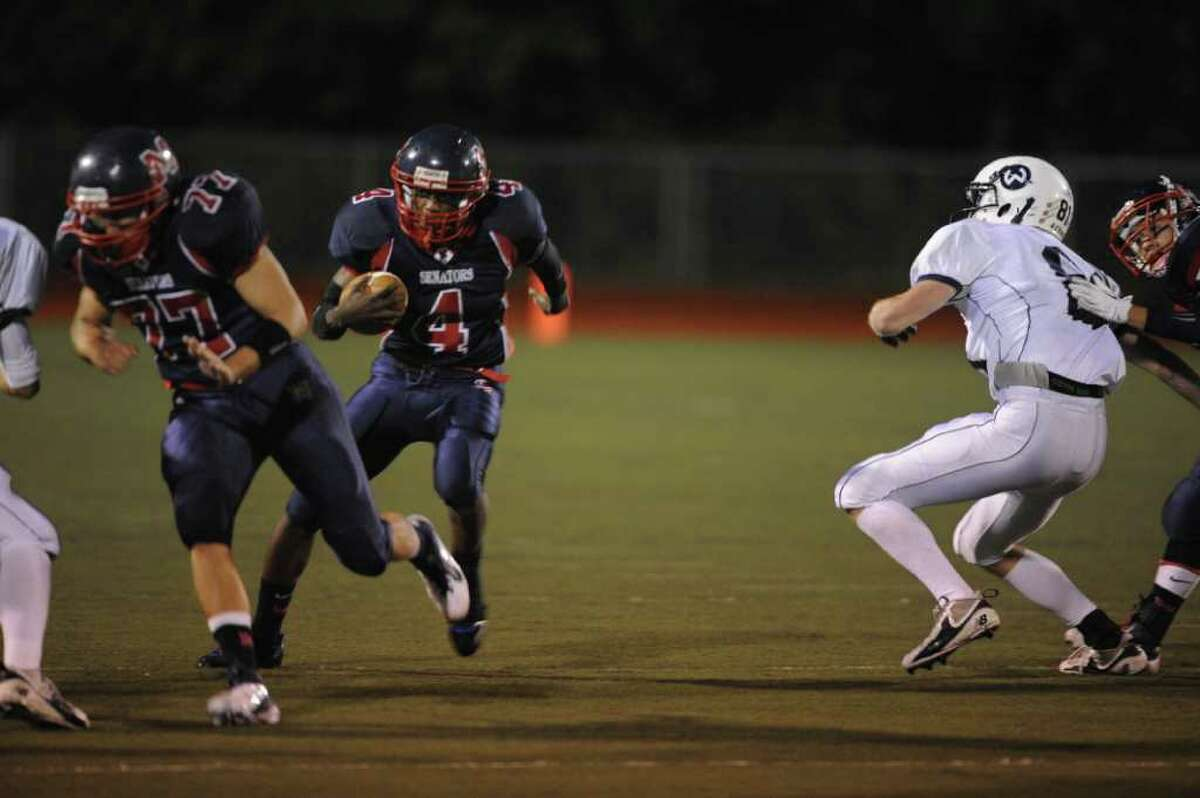 Wilton, High School Football at Brein McMahon High School Football Trevon Kinder rushes Friday Oct. 14, 2011.