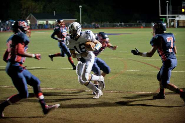 Wilton, High School Footbal Sean Carroll #16 rushes for td in the first quarter of play l at Brein McMahon High School Football Friday Oct. 14, 2011. Photo: Douglas Healey / Connecticut Post