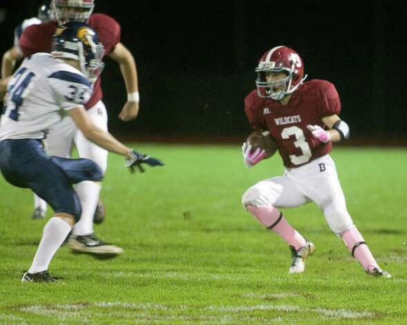 Bethel High School's James Giannone (3) tries to get around Weston High School's J.D. Simons during their SWC footbal game Friday night, Oct. 14, 2011, at Bethel High School. Photo: Barry Horn / The News-Times Freelance
