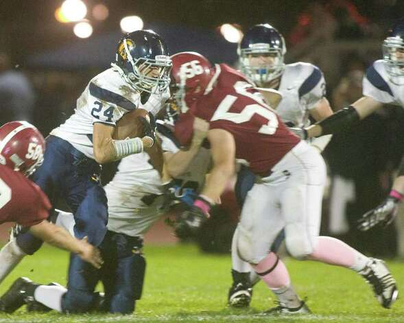 Bethel High School's Ethan Draper (56) stops Weston High School running back Justin Schaffer during their SWC football game Friday night, Oct. 14, 2011, at Bethel High School. Photo: Barry Horn / The News-Times Freelance