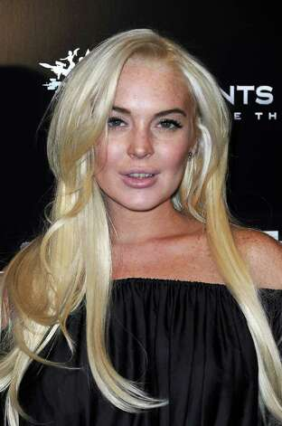 "LOS ANGELES, CA - OCTOBER 12:  Actress Lindsay Lohan attends the Premiere Of THQ's ""Saints Row: The Third"" on October 12, 2011 in Los Angeles, California.  (Photo by Valerie Macon/Getty Images) Photo: Valerie Macon / 2011 Getty Images"