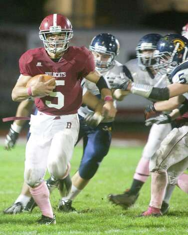Bethel High School quarterback Brandon Schmidt finds running room during an SWC football game against Weston High School Friday night, Oct. 14, 2011, at Bethel High School. Photo: Barry Horn / The News-Times Freelance