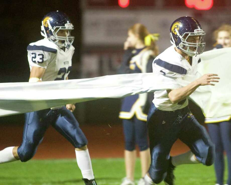 Weston High School takes the field for its SWC football game against Bethel High School Friday night, Oct. 14, 2011, at Bethel High School. Photo: Barry Horn / The News-Times Freelance