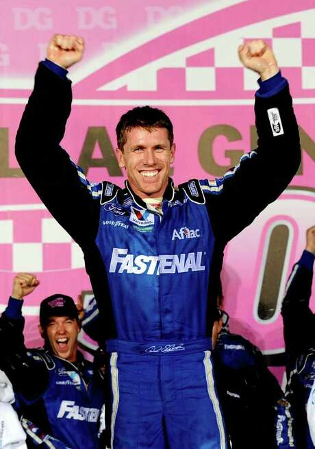 CHARLOTTE, NC - OCTOBER 14:  Carl Edwards, driver of the #60 Fastenal Ford, celebrates in Victory Lane after winning the NASCAR Nationwide Series Dollar General 300 Miles of Courage at Charlotte Motor Speedway on October 14, 2011 in Charlotte, North Carolina.  (Photo by Jason Smith/Getty Images for NASCAR) Photo: Jason Smith / 2011 Getty Images