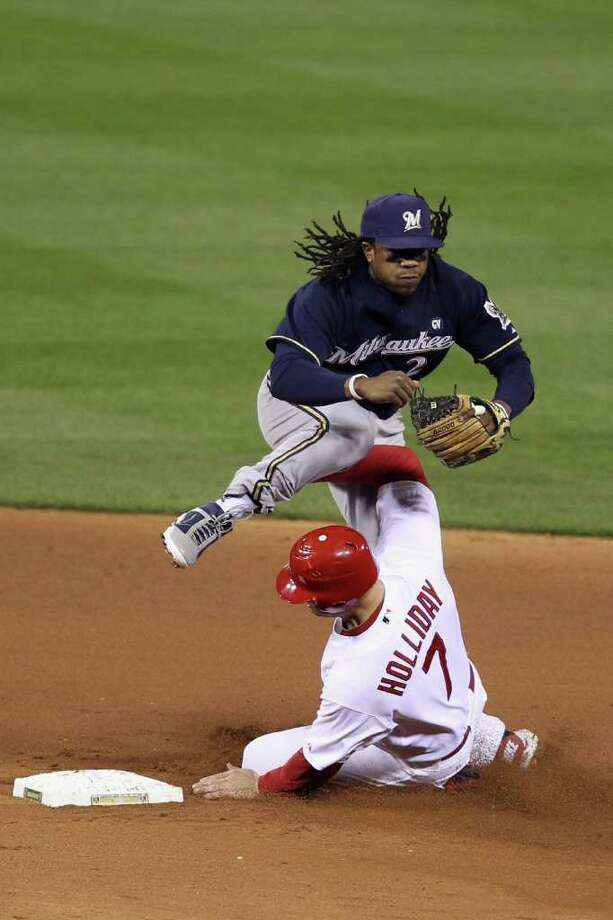 ST LOUIS, MO - OCTOBER 14:  Rickie Weeks #23 of the Milwaukee Brewers turns a double play over a sliding Matt Holliday #7 of the St. Louis Cardinals on a ball hit by David Freese #23 in the bottom of the seventh inning during Game Five of the National League Championship Series at Busch Stadium on October 14, 2011 in St Louis, Missouri. Photo: Christian Petersen, Getty / 2011 Getty Images