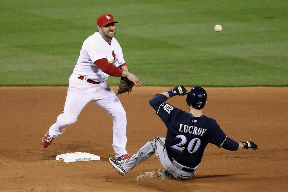 ST LOUIS, MO - OCTOBER 14:  Nick Punto #8 of the St. Louis Cardinals turns a double play over a sliding Jonathan Lucroy #20 of the Milwaukee Brewers on a ball hit by Nyjer Morgan #2 in the top of the top of the seventh inning during Game Five of the National League Championship Series at Busch Stadium on October 14, 2011 in St Louis, Missouri. Photo: Christian Petersen, Getty / 2011 Getty Images