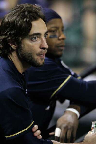 ST LOUIS, MO - OCTOBER 14:  (L-R) Ryan Braun #8 and Rickie Weeks #23 of the Milwaukee Brewers look o