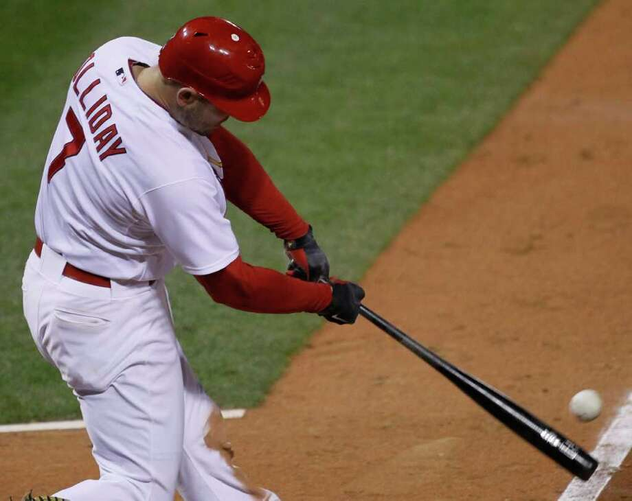 St. Louis Cardinals' Matt Holliday hits a two-run scoring double during the eighth inning of Game 5 of baseball's National League championship series against the Milwaukee Brewers Friday, Oct. 14, 2011, in St. Louis. (AP Photo/Charles Rex Arbogast) Photo: Charles Rex Arbogast, Associated Press / AP
