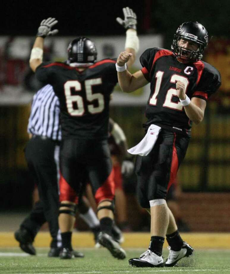 Langham Creek's Connor Feist (12) celebrates teammate Jeremiah Williams' touchdown during the second half of their District 17-5A matchup against Cy-Woods, Friday, October 14, 2011 at Berry Center in Cypress. Photo: Eric Christian Smith, For The Chronicle