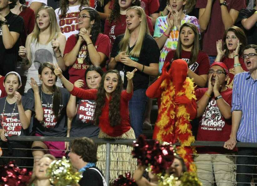 Cy-Woods student Vicky Ward (center) gestures to the Langham Creek students during a