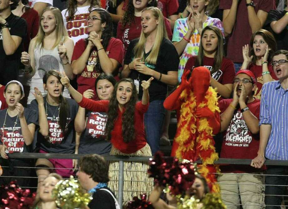 "Cy-Woods student Vicky Ward (center) gestures to the Langham Creek students during a ""We Got Spirit"" chant during the second half of their District 17-5A matchup, Friday, October 14, 2011 at Berry Center in Cypress. Photo: Eric Christian Smith, For The Chronicle"
