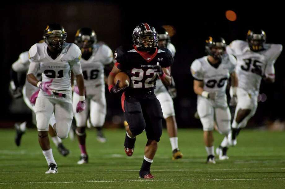 LEADER OF THE PACK: Westfield wide receiver Kaylon Jackson, center, makes a 75-yard reception Friday night while the Klein Oak defense gives chase. Photo: Nathan Lindstrom / ©2011 Nathan Lindstrom