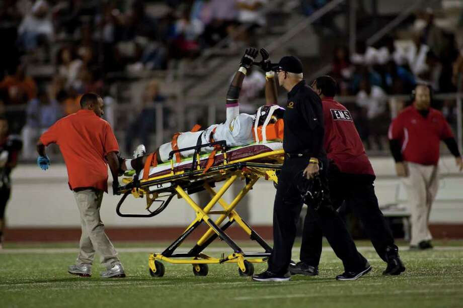 Klein Oak defensive lineman Javon Shelley (35) is rolled off the field by paramedics during District 13-5A play against Westfield Friday night October 14, 2011 at Leonard George Stadium in Spring, TX. Klein Oak, which started 0-2 this season is now undefeated in district after beating three ranked teams. 