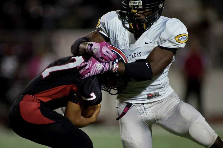 Westfield quarterback Kreigan Bridges (7) is brought down by tough Klein Oak defense in the second half of District 13-5A battle Friday night October 14, 2011 at Leonard George Stadium in Spring, TX. Klein Oak, which started 0-2 this season is now undefeated in district after beating three ranked teams. 