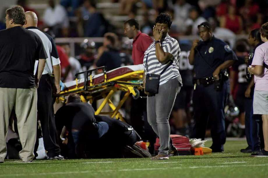 Klein Oak defensive lineman Javon Shelley (35) is checked out by paramedics before being rolled off the field during District 13-5A play against Westfield Friday night October 14, 2011 at Leonard George Stadium in Spring, TX. Klein Oak, which started 0-2 this season is now undefeated in district after beating three ranked teams. 