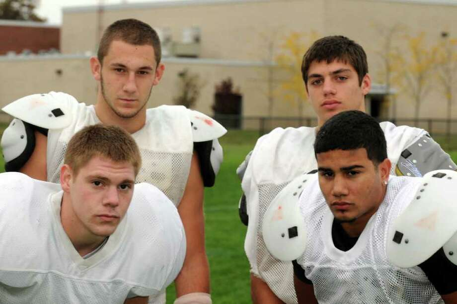 Schalmont High School football players Mike Flocuzzio, top left, Nick Gallo,top right, Jake Ayers, bottom left, and Jean Gomez during practice in  Rotterdam, NY Wednesday Oct. 12, 2011.( Michael P. Farrell/Times Union) Photo: Michael P. Farrell