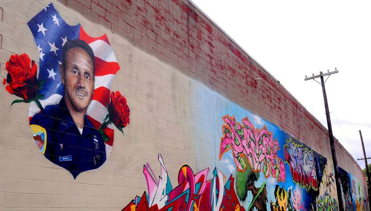 A graffiti tribute to the late Danbury police officer Bobby DiNardo on a wall near the Police Station on Main Street.