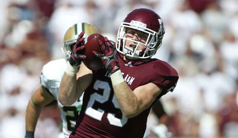 Texas A&M wide receiver Ryan Swope (25) gets behind Baylor safety Sam Holl (25) for a 68-yard touchdown catch during the second quarter of a NCAA football game at Kyle Field, Saturday, Oct. 15, 2011,  in College Station. Photo: Nick De La Torre, Houston Chronicle / © 2011  Houston Chronicle