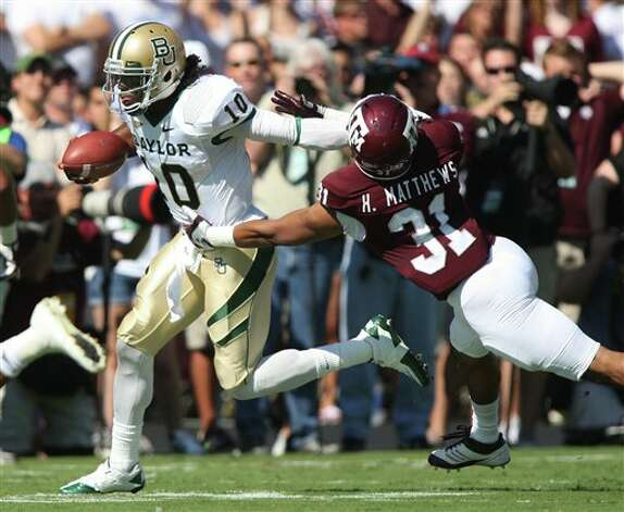 Baylor quarterback Robert Griffin III (10) runs the ball against Texas A&M's Howard Matthews (31) during the first half of an NCAA college football game Saturday, Oct. 15, 2011, in College Station, Texas. (AP Photo/Jon Eilts) Photo: Jon Eilts, Associated Press / FR170396 AP