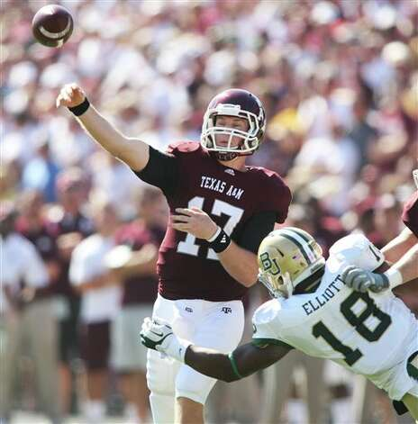 Texas A&M quarterback Ryan Tannehill (17) throws the ball against Baylor defender Tevin Elliott (18) during the first half of an NCAA college football game Saturday, Oct. 15, 2011, in College Station, Texas. (AP Photo/Jon Eilts) Photo: Jon Eilts, Associated Press / FR170396 AP