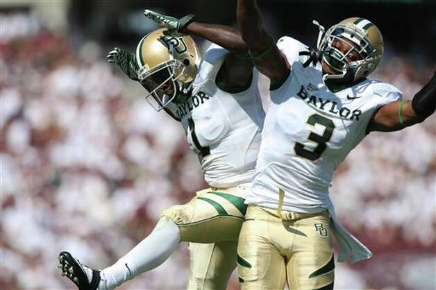 Baylor teammates Kendall Wright (1) and Lanear Sampson (3) celebrate after Wright scored during the first half of an NCAA college football game against Texas A&M Saturday, Oct. 15, 2011, in College Station, Texas. (AP Photo/Jon Eilts) Photo: Jon Eilts, Associated Press / FR170396 AP