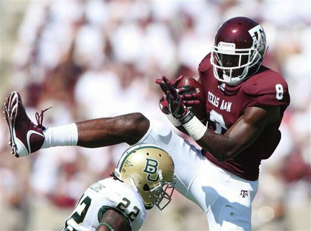 Texas A&M's Jeff Fuller (8) catches the ball over Baylor defender Joe Williams (22) during the first half of an NCAA college football game Saturday, Oct. 15, 2011, in College Station, Texas. (AP Photo/Jon Eilts) Photo: Jon Eilts, Associated Press / FR170396 AP