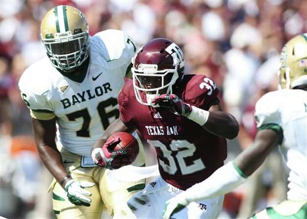 Texas A&M's Cyrus Gray (32) runs the ball against Baylor defender Nick Johnson (76) during the first half of an NCAA college football game Saturday, Oct. 15, 2011, in College Station, Texas. (AP Photo/Jon Eilts) Photo: Jon Eilts, Associated Press / FR170396 AP