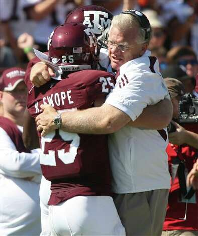 Texas A&M head coach Mike Sherman, right, celebrates with Ryan Swope, left, after Swope scored during the first half of an NCAA college football game against Baylor, Saturday, Oct. 15, 2011, in College Station, Texas. (AP Photo/Jon Eilts) Photo: Jon Eilts, Associated Press / FR170396 AP