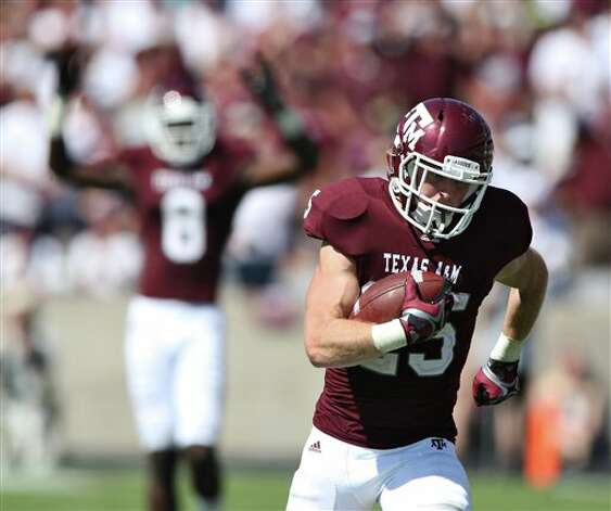 Texas A&M's Ryan Swope (25) runs the ball in for a touchdown while teammate Jeff Fuller (8) celebrates during the second half of an NCAA college football game against Baylor, Saturday, Oct. 15, 2011, in College Station, Texas. Texas A&M won 55-28. (AP Photo/Jon Eilts) Photo: Associated Press