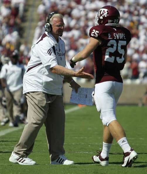 Texas A&M head coach Mike Sherman congratulates Texas A&M wide receiver Ryan Swope (25) on a touchdo