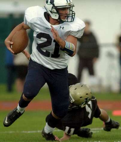 Immaculate's James Coppolla, left, runs the ball while under pressure from Joel Barlow's Alex Gombos during their game at Joel Barlow High School in Redding on Saturday, Oct. 15, 2011.  Barlow won 48-12. Photo: Jason Rearick / The News-Times