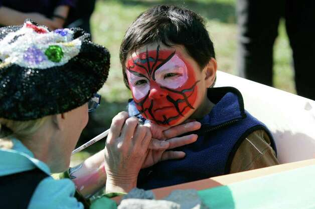 Liam Curran, 4, is Spiderman for a day as he and hundreds of other participants turned out for My Park Day, a celebration of the ground breaking ceremony at Mill River Park in Stamford. The 12 acre park is in its first phase of work to restore its pristine grounds.  © J. Gregory Raymond Photo: J. Gregory Raymond / © J. Gregory Raymond/Stamford Advocate