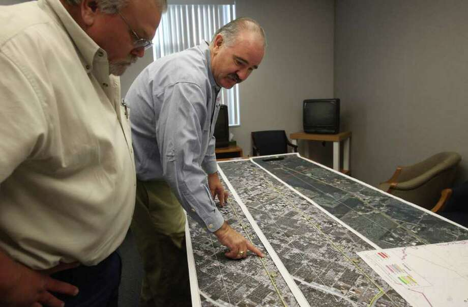 Precinct 4 General Superintendent Bill Lee, left, and Harris County Commissioner Jack Cagle review road maps during a tour of the Lyons Road Camp last week. Photo: Mayra Beltran / © 2011 Houston Chronicle