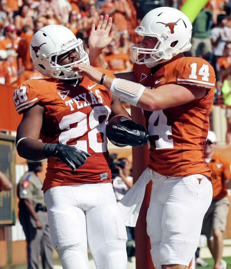QB David Ash (right) will enter fall with another year of seasoning and plenty of help, including running back Malcolm Brown, a Steele product. Photo: EDWARD A. ORNELAS, Express-News / © SAN ANTONIO EXPRESS-NEWS (NFS)