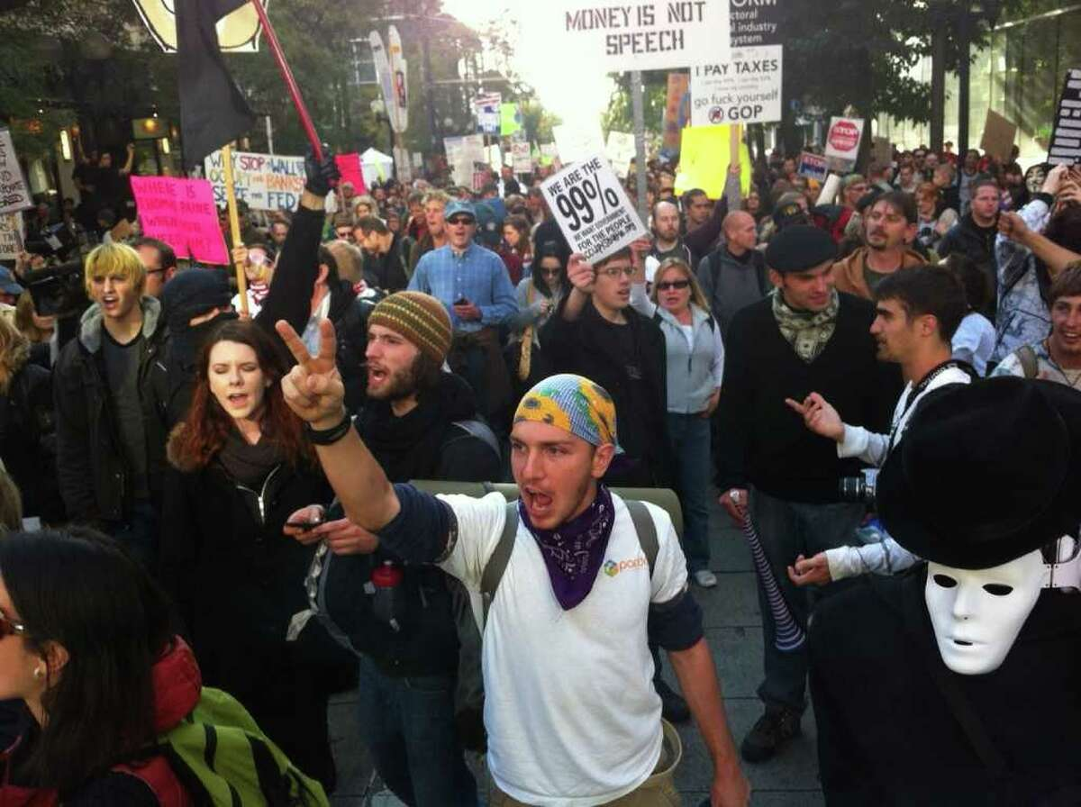 """""""Occupy Seattle"""" protesters march in Seattle on Oct. 15, 2011."""