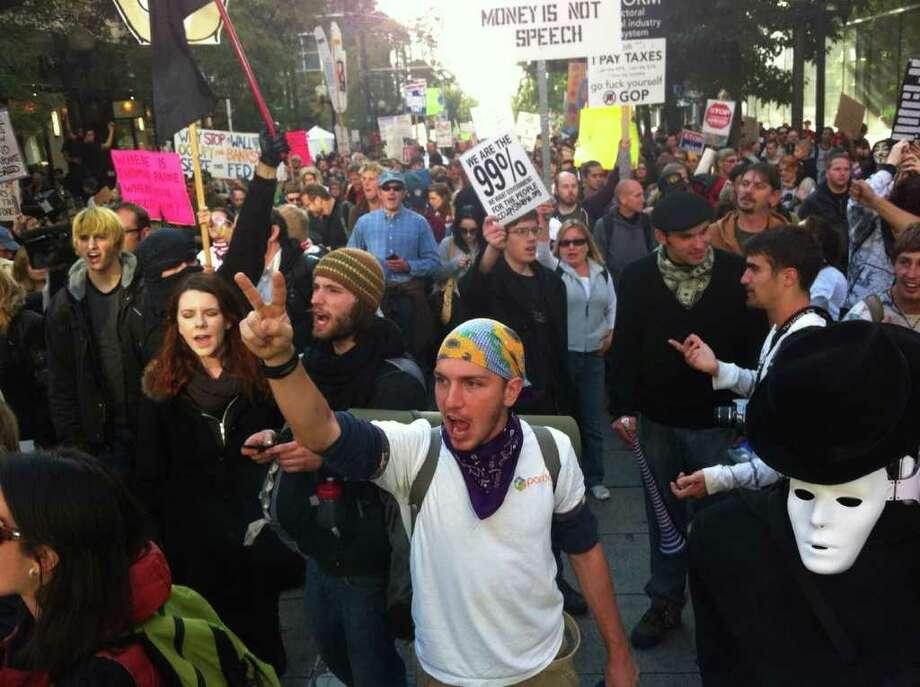 """Occupy Seattle"" protesters march in Seattle on Oct. 15, 2011. Photo: Joshua Trujillo/seattlepi.com"