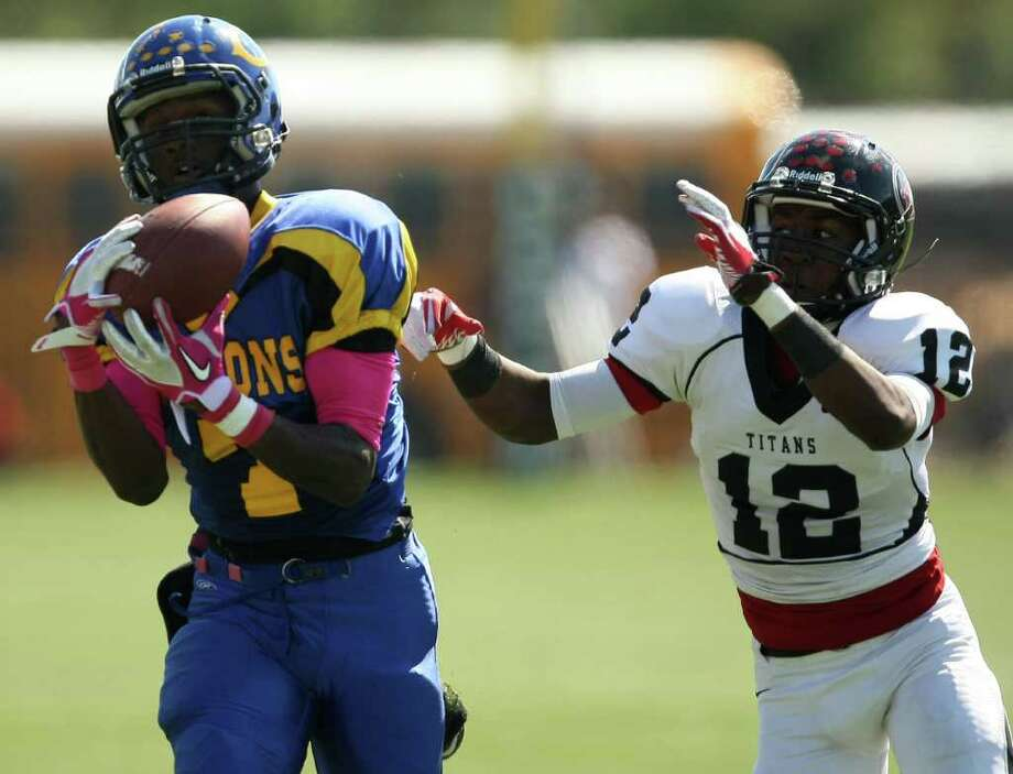 Channelview's Marquise Johnson (left) catches a 50-yard touchdown pass past PA Memorial's Roderic Rucker during the first half of a high school football game, Saturday, October 15, 2011 at Stallworth Stadium in Baytown. Photo: Eric Christian Smith, For The Chronicle