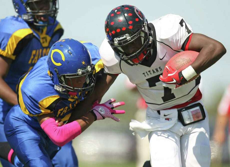 PA Memorial's Terrence Singleton (right) is tackled by Channelview's Kelvin Young during the first half of a high school football game, Saturday, October 15, 2011 at Stallworth Stadium in Baytown. Photo: Eric Christian Smith, For The Chronicle