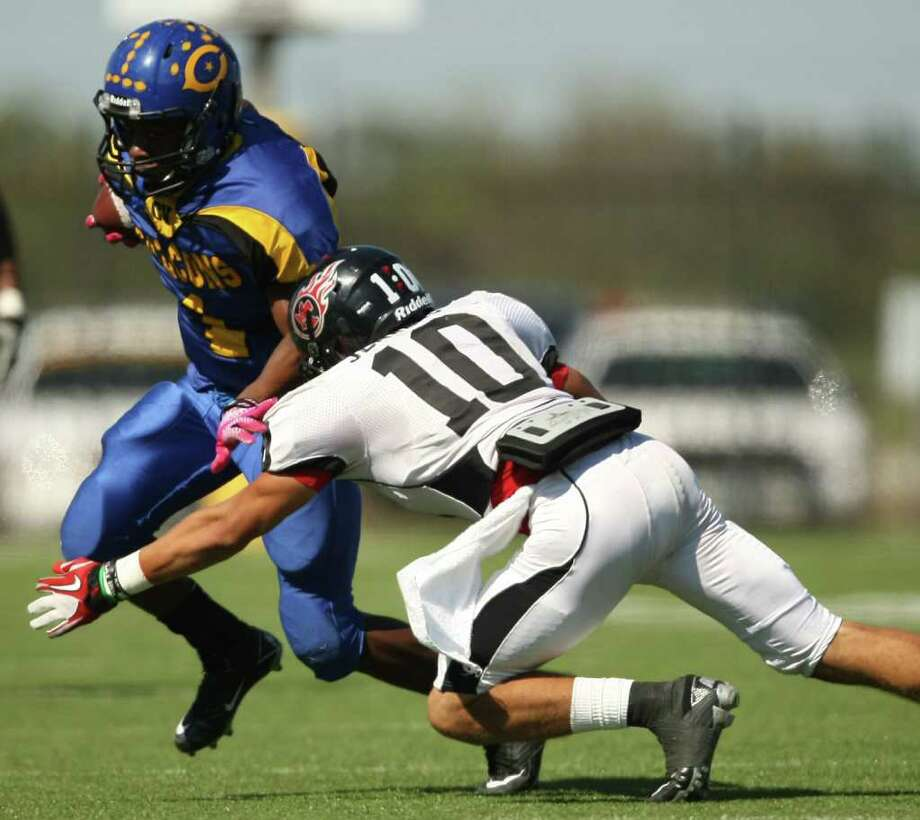 Channelview's Stanley Wesley (left) escapes the tackle of PA Memorial's James Jenkins during the first half of a high school football game, Saturday, October 15, 2011 at Stallworth Stadium in Baytown. Photo: Eric Christian Smith, For The Chronicle