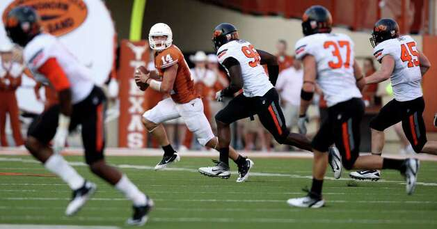 Texas' David Ash (center) looks to pass against Oklahoma State during second half action Saturday Oct. 15, 2011at Texas Memorial Stadium in Austin, Tx. Oklahoma State won 38-26. Photo: EDWARD A. ORNELAS, Express-News / © SAN ANTONIO EXPRESS-NEWS (NFS)