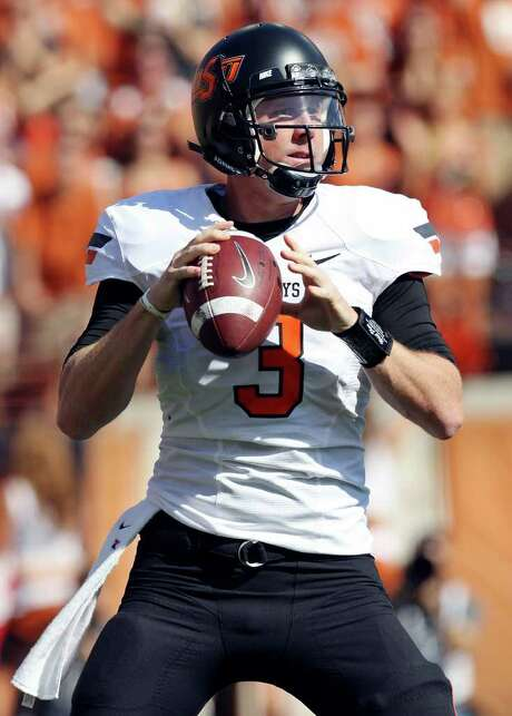 Senior QB Brandon Weeden will leave Oklahoma State with a claim to at least 19 school records. Photo: EDWARD A. ORNELAS, Express-News / © SAN ANTONIO EXPRESS-NEWS (NFS)
