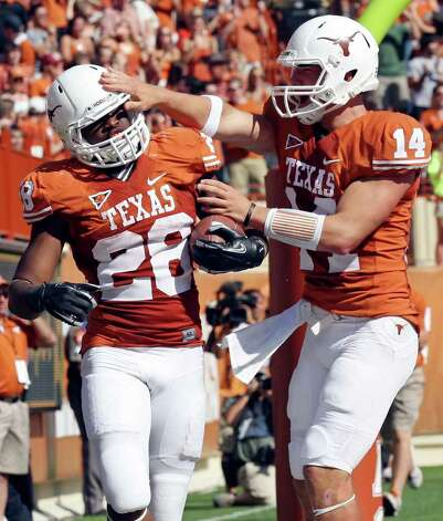 Texas' Malcolm Brown (left) is congratulated by teammate Texas' David Ash after scoring a touchdown against Oklahoma State during first half action Saturday Oct. 15, 2011at Texas Memorial Stadium in Austin, Tx. Photo: EDWARD A. ORNELAS, Express-News / © SAN ANTONIO EXPRESS-NEWS (NFS)