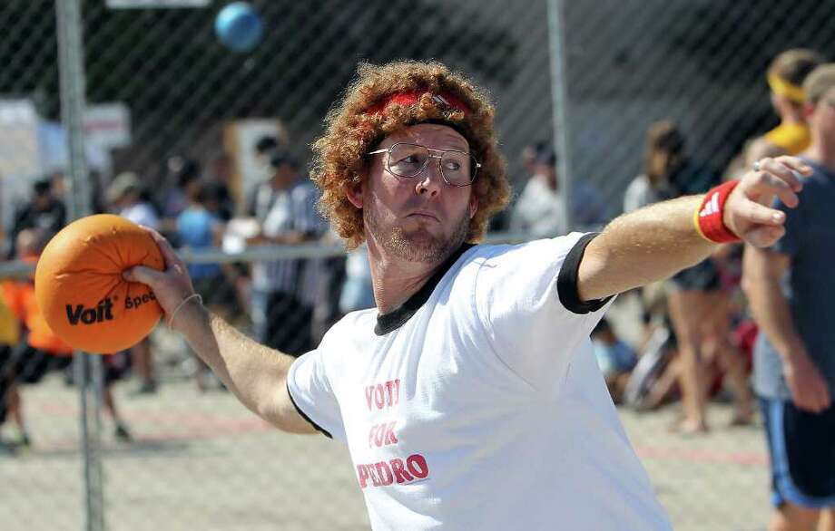 Matt White dresses as movie character Napolean Dynamite while hurling a ball at the 2011 Duck N Dodge City Dodgeball Championships at the Alamodome on Saturday, Oct. 15, 2011. The entry fees go to the non-profit San Antonio Sports youth programs. Over 70 teams came out to play. Photo: KIN MAN HUI, Kin Man Hui/kmhui@express-news.net / SAN ANTONIO EXPRESS-NEWS