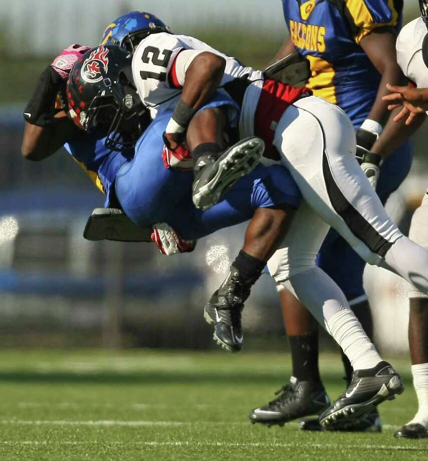 Channelview's Terrell Williams (left) is upended for a loss by PA Memorial's Roderic Rucker during the second half of a high school football game, Saturday, October 15, 2011 at Stallworth Stadium in Baytown. Photo: Eric Christian Smith, For The Chronicle