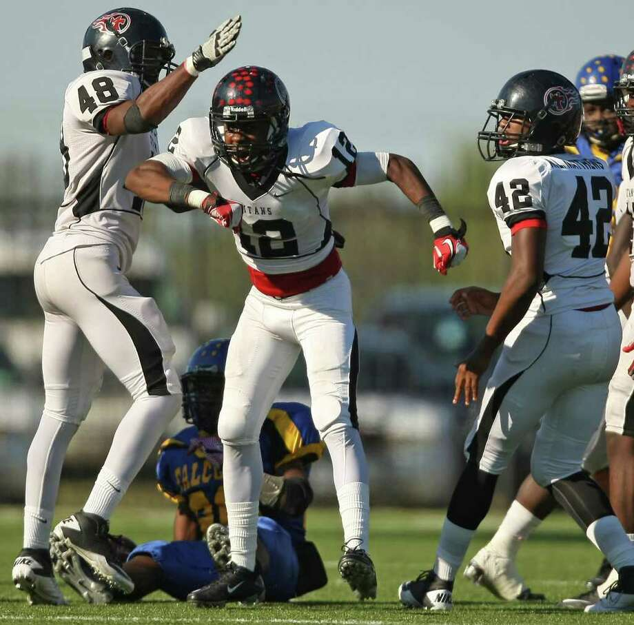 PA Memorial's Roderic Rucker (12) celebrates his tackle of Channelview's Terrell Williams (20) during the second half of a high school football game, Saturday, October 15, 2011 at Stallworth Stadium in Baytown. Photo: Eric Christian Smith, For The Chronicle