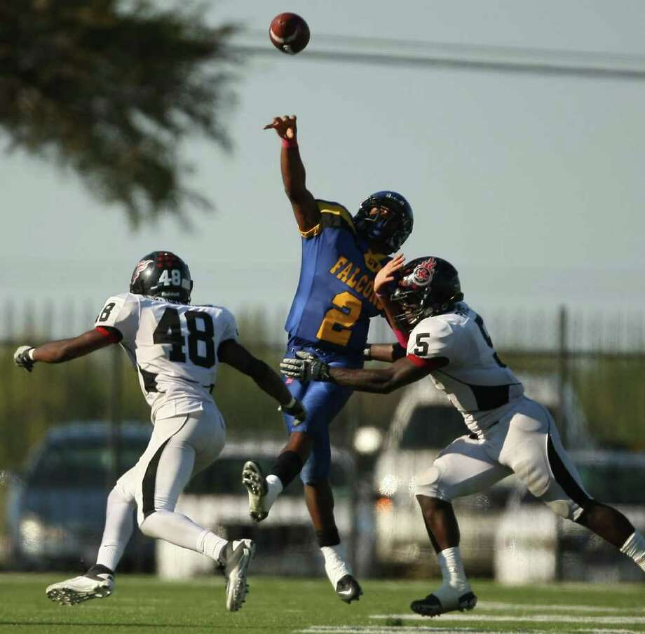 Channelview's Averion Hurts (2) just gets off a pass as PA Memorial's Joshua Pickett (5) and Melbrodrick Matthews defend during the second half of a high school football game, Saturday, October 15, 2011 at Stallworth Stadium in Baytown. Photo: Eric Christian Smith, For The Chronicle