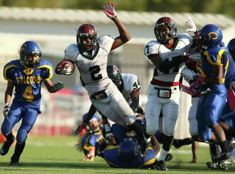 PA Memorial's Nathan Holmes (2) is tackled by Channelview's Devin Phillips during the second half of a high school football game, Saturday, October 15, 2011 at Stallworth Stadium in Baytown. Photo: Eric Christian Smith, For The Chronicle